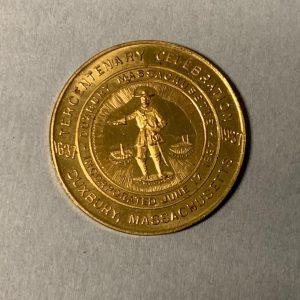 Golden coin, Tercentenary, Duxbury, Massachusetts (front view)