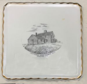 Ceramic tile with image of the Alden House at center.