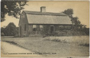 Postcard of a saltbox house in black and white