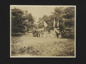 Group of people standing in graveyard with cannons.