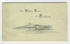 Paper cover booklet with waterfront, sailing boats and monument on hill.